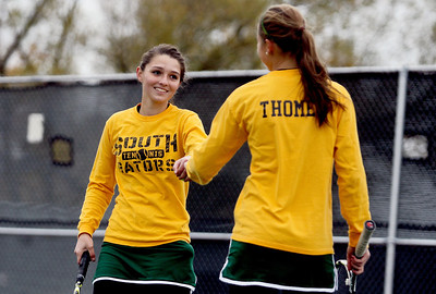 Sarah Nader - snader@shawmedia.com Crystal Lake South's Julia Thome (left) and Marisa Thome celebrate a point while competing in a doubles game during Thursday's state tennis tournament in Rolling Meadows on October 18, 2012.
