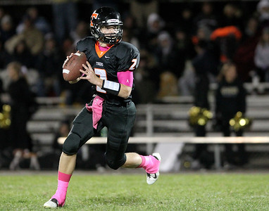 Mike Greene - mgreene@shawmedia.com Crystal Lake Central quarterback Kyle Lavand rolls out looking for open receivers during the third quarter of a game against Grayslake North Friday, October 5, 2012 at Crystal Lake Central. Grayslake North (6-1) defeated Crystal Lake Central (5-2) 32-20 to clinch a playoff spot.