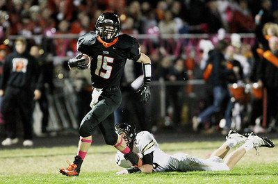 Mike Greene - mgreene@shawmedia.com Crystal Lake Central wide receiver Isaiah Mosher gets by Grayslake North defensive back Charlie Pine during an end around in the second quarter of a game Friday, October 5, 2012 at Crystal Lake Central. Mosher scored on the play but Crystal Lake Central (5-2) lost to Grayslake North (6-1) 32-20.