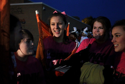 Mike Greene - mgreene@shawmedia.com Crystal Lake Central junior Melissa Henry (center) and other members of the color guard wrap themselves in their flags to stay warm before a game against Grayslake North Friday, October 5, 2012 at Crystal Lake Central. Grayslake North (6-1) defeated Crystal Lake Central (5-2) 32-20 to clinch a playoff spot.