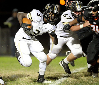 Mike Greene - mgreene@shawmedia.com Grayslake North's Dylan Foster crosses the goal line for a touchdown during the first quarter of a game against Crystal Lake Central Friday, October 5, 2012 at Crystal Lake Central. Grayslake North (6-1) defeated Crystal Lake Central (5-2) 32-20 to clinch a playoff spot.