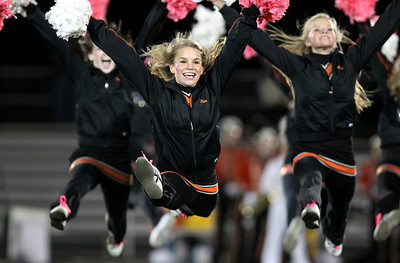 Mike Greene - mgreene@shawmedia.com Crystal Lake Central junior Olivia Barkocy does a split leap while performing with the varsity dance team during halftime of a game against Grayslake North Friday, October 5, 2012 at Crystal Lake Central. Grayslake North (6-1) defeated Crystal Lake Central (5-2) 32-20 to clinch a playoff spot.