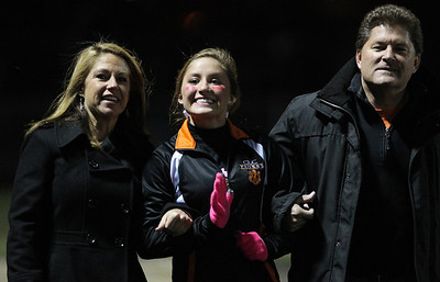 Mike Greene - mgreene@shawmedia.com Crystal Lake Central senior dance team member Bianca Bialk walks with her parents Gail and Gary as part of Senior Night before the start of a game against Grayslake North Friday, October 5, 2012 at Crystal Lake Central. Grayslake North (6-1) defeated Crystal Lake Central (5-2) 32-20 to clinch a playoff spot.