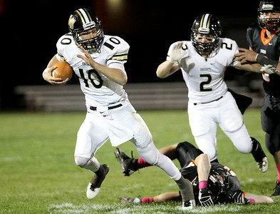 Mike Greene - mgreene@shawmedia.com Grayslake North quarterback A.J. Fish runs past Crystal Lake Central defenders during the first quarter of a game Friday, October 5, 2012 at Crystal Lake Central. Fish threw for 250 yards and 4 touchdowns in Grayslake North's (6-1) 32-20 defeat of Crystal Lake Central (5-2) and earned a spot in the playoffs.
