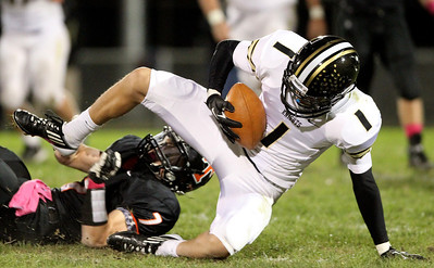 Mike Greene - mgreene@shawmedia.com Grayslake North wide receiver Anthony Diggs holds onto the ball after being tackled by Crystal Lake Central cornerback Jordan Wallace during the second quarter of a game Friday, October 5, 2012 at Crystal Lake Central. Grayslake North (6-1) defeated Crystal Lake Central (5-2) 32-20 to clinch a playoff spot.