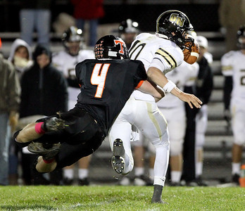 Mike Greene - mgreene@shawmedia.com Crystal Lake Central linebacker Nathan Talbott dives to sack Grayslake North quarterback A.J. Fish during the fourth quarter of a game Friday, October 5, 2012 at Crystal Lake Central. Grayslake North (6-1) defeated Crystal Lake Central (5-2) 32-20 to clinch a playoff spot.