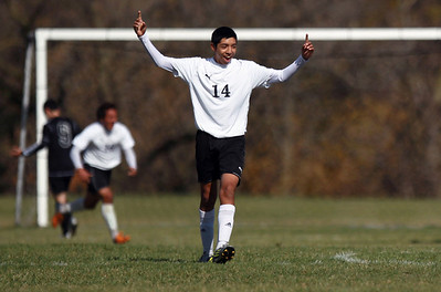 Sarah Nader - snader@shawmedia.com Harvard's Cristian Juarez celebrates a goal made by his teammate during the second half of  Saturday's Regional Final against Woodstock North on October 20, 2012 in Harvard. Harvard won, 2-0.