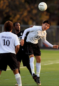 Sarah Nader - snader@shawmedia.com Harvard's Angel Sanchez (right) heads the ball during the second half of Wednesday's Class 2A Grayslake Central Sectional Semifinal game against Grayslake North in Grayslake on October 24, 2012. Harvard won, 1-0.