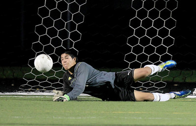 Sarah Nader - snader@shawmedia.com Harvard's goalkeeper blocks a goal during a shootout after double overtime against Grayslake North at Wednesday's Class 2A Grayslake Central Sectional Semifinal in Grayslake on October 24, 2012. Harvard won, 1-0.