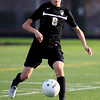 Harvard defeats Grayslake North : Harvard's Fernando Mercado kicks the ball down field during  the first half of Wednesday's Class 2A Harvard won the Grayslake Central Sectional Semifinal game against Grayslake North in Grayslake on October 24, 2012. Harvard won, 1-0.