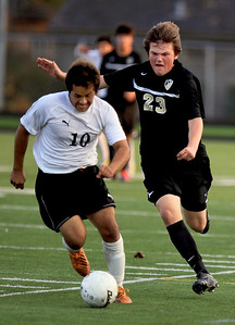 Sarah Nader - snader@shawmedia.com Harvard's Eduardo Juarez (left) is guarded by Grayslake North's Zach Kottmer during overtime at Wednesday's Class 2A Grayslake Central Sectional Semifinal game in Grayslake on October 24, 2012. Harvard won, 1-0.