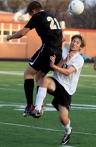 Sarah Nader - snader@shawmedia.com Grayslake North's Michael Rohrer (left) and Harvard's William Rockcastle collide while going after the ball in the second half  of Wednesday's Class 2A Grayslake Central Sectional Semifinal game in Grayslake on October 24, 2012. Harvard won, 1-0.