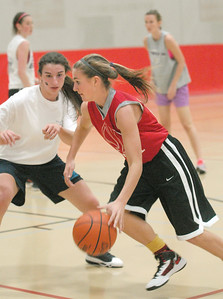Gabrielle Rush drives to the basket against Maddie Roglich on Wednesday, Oct. 31, 2012, at Hinsdale Central girls basketball practice. Practices started this week. Staff photo by Bill Ackerman