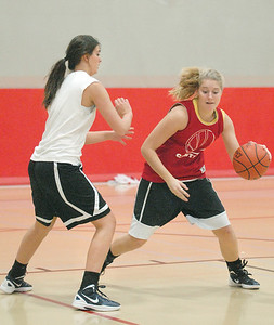 Jenna Broz guards Lily Sarros  on Wednesday, Oct. 31, 2012, at Hinsdale Central girls basketball practice. Practices started this week. Staff photo by Bill Ackerman