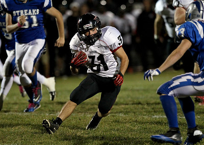 Josh Peckler - Jpeckler@shawmedia.com Huntley's Jake Scalise runs with the ball against Woodstock during the second quarter at Woodstock High School Friday, October 12, 2012.