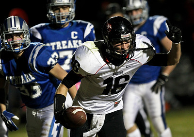 Josh Peckler - Jpeckler@shawmedia.com Huntley's Bryce Beschorner celebrates scoring a touchdown during the first quarter at Woodstock High School Friday, October 12, 2012.