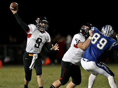 Josh Peckler - Jpeckler@shawmedia.com Huntley quarterback Kameron Sallee lets pass go during the second quarter at Woodstock High School Friday, October 12, 2012.