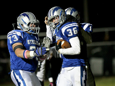 Josh Peckler - Jpeckler@shawmedia.com Woodstock's Nick Rogers (36) is congratulated by teammate Kyle Woodall (73) after he scored a touchdown against Huntley during the second quarter at Woodstock High School Friday, October 12, 2012.