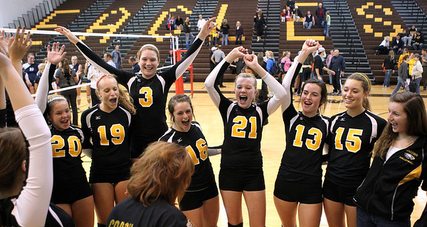 Mike Greene - mgreene@shawmedia.com Jacobs' players react after defeating Cary-Grove in a match Thursday, October 4, 2012 at Jacobs High School in Algonquin. Jacobs (16-5) defeated Cary-Grove (12-12) in straight sets 25-17, 25-23.