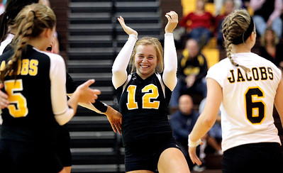 Mike Greene - mgreene@shawmedia.com Jacobs' Mackenzie Traub celebrates after scoring a point during a match against Cary-Grove Thursday, October 4, 2012 at Jacobs High School in Algonquin. Jacobs (16-5) defeated Cary-Grove (12-12) in straight sets 25-17, 25-23.