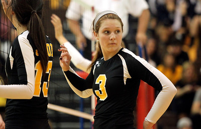 Mike Greene - mgreene@shawmedia.com Jacobs' Alyssa Ehrhardt listens to coaches while at the net during a match against Cary-Grove Thursday, October 4, 2012 at Jacobs High School in Algonquin. Jacobs (16-5) defeated Cary-Grove (12-12) in straight sets 25-17, 25-23.