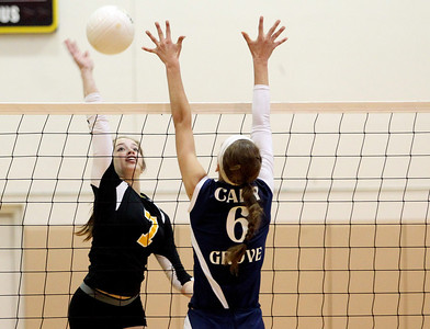 Mike Greene - mgreene@shawmedia.com Jacobs' Rachel Arceneaux prepares to spike the ball as Cary-Grove's Amy Jereb defends during a match Thursday, October 4, 2012 at Jacobs High School in Algonquin. Jacobs (16-5) defeated Cary-Grove (12-12) in straight sets 25-17, 25-23.