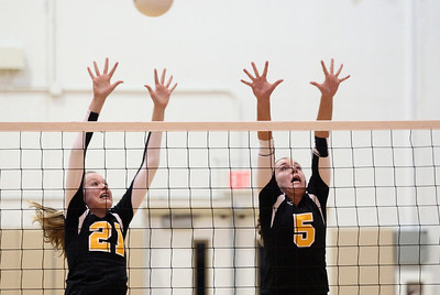 Mike Greene - mgreene@shawmedia.com Jacobs' Bridget Wallenberger (left) and Maris Smith jump while attempting to defend during a match against Cary-Grove Thursday, October 4, 2012 at Jacobs High School in Algonquin. Jacobs (16-5) defeated Cary-Grove (12-12) in straight sets 25-17, 25-23.