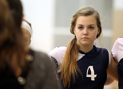 Mike Greene - mgreene@shawmedia.com Cary-Grove's Bree Coffey listens to head coach Patty Langanis during a timeout in a match against Jacobs Thursday, October 4, 2012 at Jacobs High School in Algonquin. Jacobs (16-5) defeated Cary-Grove (12-12) in straight sets 25-17, 25-23.