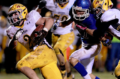 Sarah Nader - snader@shawmedia.com Jacobs' Greg Sidor runs a play during the first quarter of Friday's game against Dundee-Crown in Carpentersville on October 19, 2012. Jacobs won, 21-3.