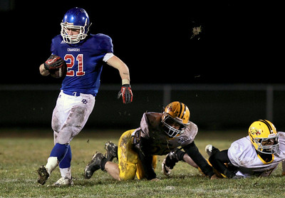 Sarah Nader - snader@shawmedia.com Dundee-Crown's Cody Lane runs a play during Friday's game against Jacobs in Carpentersville on October 19, 2012. Jacobs won, 21-3.