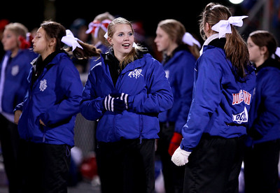 Sarah Nader - snader@shawmedia.com The Dundee-Crown cheerleaders talk during Friday's game against Jacobs in Carpentersville on October 19, 2012. Jacobs won, 21-3.