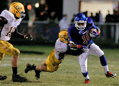 Sarah Nader - snader@shawmedia.com Jacobs' Ryan Downing (left) tackles Dundee-Crown's J.T. Beasley during the first quarter of Friday's game in Carpentersville on October 19, 2012. Jacobs won, 21-3.