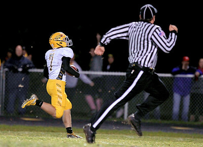 Sarah Nader - snader@shawmedia.com Jacobs' Hunter Williams scores a touchdown during the first quarter of Friday's game against Dundee-Crown in Carpentersville on October 19, 2012. Jacobs won, 21-3.