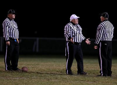 Sarah Nader - snader@shawmedia.com Referees talk during Friday's in Carpentersville on October 19, 2012. Jacobs won, 21-3.