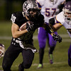 Karen Naess For The Kane County Chronicle<br />   Kaneland's Jesse Balluff runs with the ball as Belvidere's Jacob Fondrk looks to make the stop in playoff play on Saturday at Kaneland.