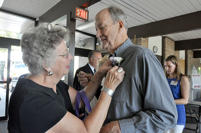 Sarah Minor — sminor@shawmedia.com Nadine Ilten pins a boutonniere on her husband Jim who was a nominee for Lombard Senior of the Year Wednesday, Oct. 2, 2013 at the Lombard Senior Fair.