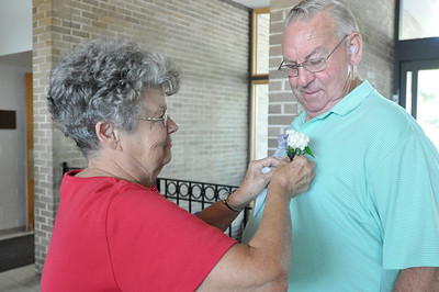 Sarah Minor — sminor@shawmedia.com Elsie Haake pins a boutonniere on her husband Darrel who was a nominee for Lombard Senior of the Year Wednesday, Oct. 2, 2013 at the Lombard Senior Fair.