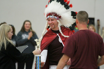 Mike Greene - mgreene@shawmedia.com Teacher David McCafferty accepts the teacher spirit award during a homecoming pep rally at Marengo High School Friday, October 12, 2012 in Marengo. Marengo wrapped up homecoming week with a varsity football game against Rockford Christian.