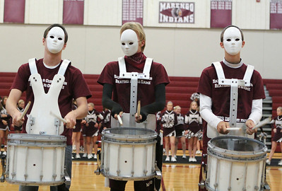 Mike Greene - mgreene@shawmedia.com Drum line members Jesse Darlington, Malachi Allgood, and Weyland Heimer perform in masks during a homecoming pep rally at Marengo Community High School Friday, October 12, 2012 in Marengo. Marengo wrapped up homecoming week with a varsity football game against Rockford Christian.
