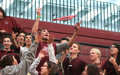 Mike Greene - mgreene@shawmedia.com Senior Steve Galante reaches out to catch an Indian headdress during a homecoming pep rally at Marengo Community High School Friday, October 12, 2012 in Marengo. Marengo wrapped up homecoming week with a varsity football game against Rockford Christian.