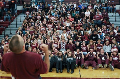 Mike Greene - mgreene@shawmedia.com Dan Schirmer leads the senior class in a mock roller-coaster during a homecoming pep rally at Marengo Community High School Friday, October 12, 2012 in Marengo. Marengo wrapped up homecoming week with a varsity football game against Rockford Christian.