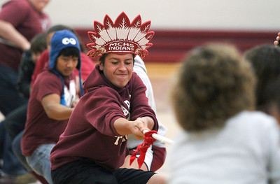 Mike Greene - mgreene@shawmedia.com Senior Aaron Deleon pulls a rope with classmates while facing a group of teachers in Tug of War during a homecoming pep rally at Marengo Community High School Friday, October 12, 2012 in Marengo. Marengo wrapped up homecoming week with a varsity football game against Rockford Christian.
