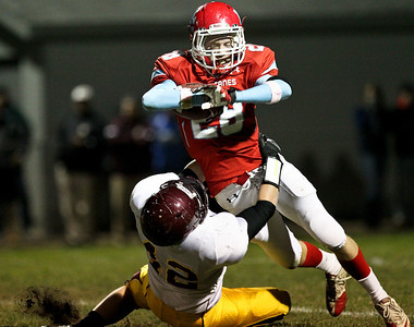 Josh Peckler - Jpeckler@shawmedia.com Marian Central's Ryan Hickey gets tackled by Montini's Charles Long while running the ball during the second quarter at Marian Central High School Friday, October 5, 2012. Marian Central won the game 49-24.