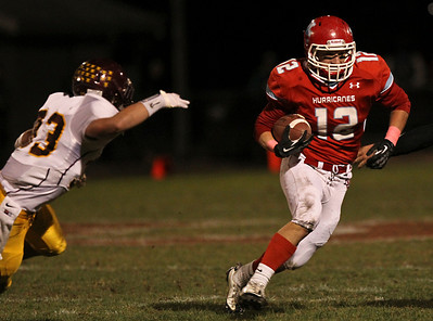 Josh Peckler - Jpeckler@shawmedia.com Marian Central's Greg Walczak runs with the ball during the second quarter against Montini at Marian Central High School Friday, October 5, 2012. Marian Central won the game 49-24.