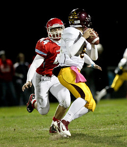 Josh Peckler - Jpeckler@shawmedia.com Marian Central's Thomas Lesniewski (44) stares down Montini quarterback Alexander Wills right before sacking him in the first quarter at Marian Central High School Friday, October 5, 2012. Marian Central won the game 49-24.