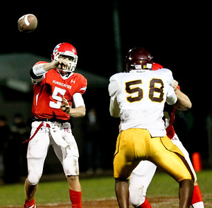 Josh Peckler - Jpeckler@shawmedia.com Marian Central quarterback Chris Streveler throws the ball during the second quarter against Montini at Marian Central High School Friday, October 5, 2012. Marian Central won the game 49-24.