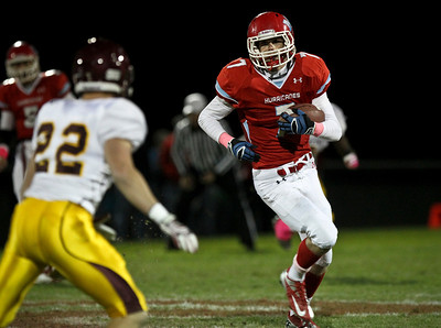 Josh Peckler - Jpeckler@shawmedia.com Marian Central's Tommy Waytula runs with the ball during the second quarter against Montini at Marian Central High School Friday, October 5, 2012. Marian Central won the game 49-24.