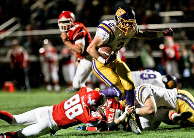 Josh Peckler - Jpeckler@shawmedia.com Wauconda's David Starkey runs the ball against Marian Central during the second quarter at Marian Central High School Friday, October 26, 2012. Marian Central defeated Wauconda 42-10 in a IHSA 5A first round playoff game.