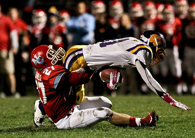 Josh Peckler - Jpeckler@shawmedia.com Marian Central's Chris Daniels (27) tackles Wauconda's Chris Kass during the second quarter against Wauconda at Marian Central High School Friday, October 26, 2012. Marian Central defeated Wauconda 42-10 in a IHSA 5A first round playoff game.