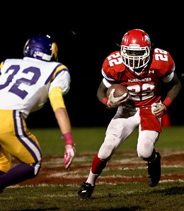 Josh Peckler - Jpeckler@shawmedia.com Marian Central's Ephraim Lee runs the ball against Wauconda during the third quarter at Marian Central High School Friday, October 26, 2012. Marian Central defeated Wauconda 42-10 in a IHSA 5A first round playoff game.